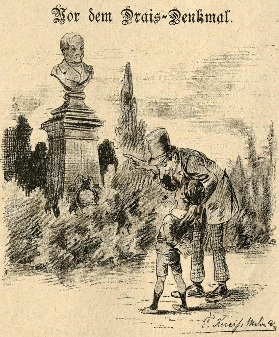 Vater und Sohn vor dem Drais-Denkmal in Karlsruhe