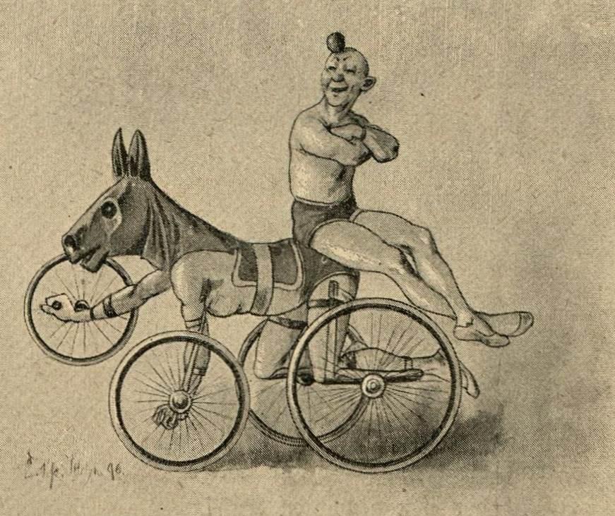 Clown mit radfahrendem Esel (in dem ein Mensch steckt)